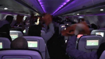 Giants Fans Celebrate Win Aboard Virgin Flight