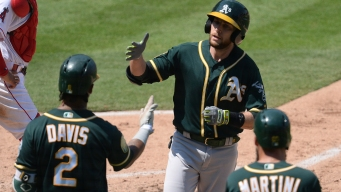 Seven A's Drive in Runs as They Hold Off Angels