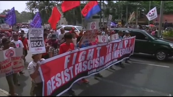 Protesters March Against Trump in Philippines, UK