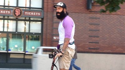 Brian Wilson Rides Scooter to Work in Air Mags