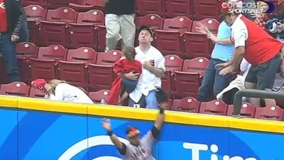 Fan Catches Home Run While Holding Baby