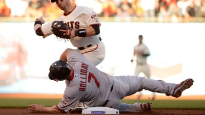 Holliday, Cards Defend Dirty Slide