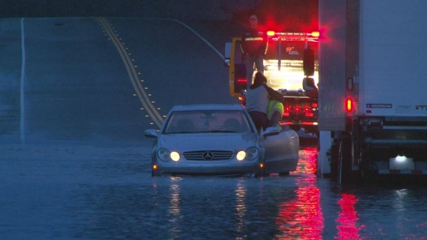 RAW: Truck Driver Saves Stranded Motorist from North Bay Flood Waters