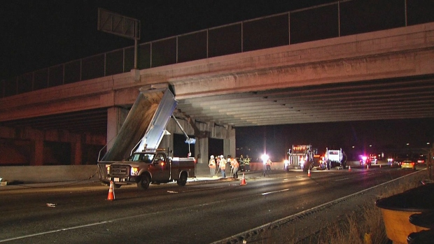 Dump Truck's Box Pinned Against Overpass