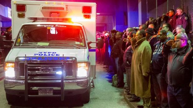[NATL] Dramatic Photos: 2 NYPD Officers Killed in Ambush