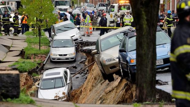 [NATL-DC] Dramatic Photos: Block-Long Baltimore Sinkhole Swallows Cars