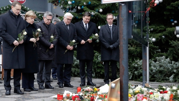[NATL] Germany Mourns Berlin Victims; ISIS Claims Attack
