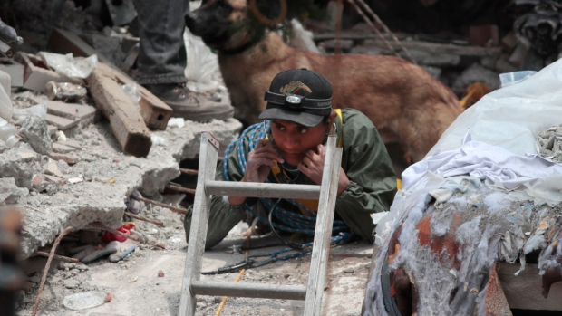 Rescuers search collapsed buildings in Mexico for survivors