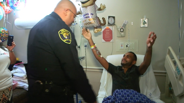 [NATL] Orlando Survivor Reunited With Cop Who Helped Save His Life