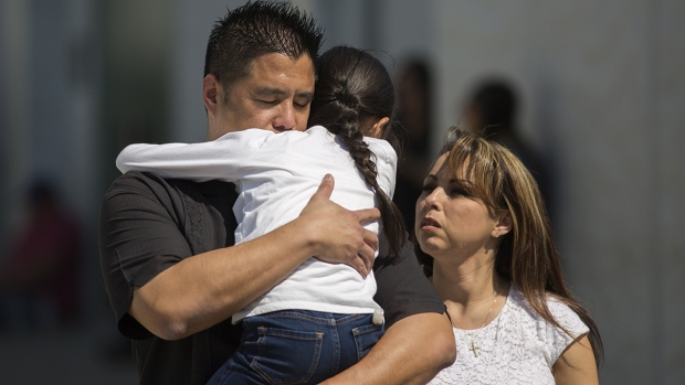 [NATL-la gallery] Photos: Emotional Reunions Follow San Bernardino School Shooting for Parents, Children