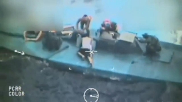 RAW: US Coast Guard Takes Colombian Suspects Off Boat During Cocaine Heist