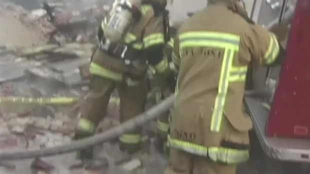 RAW VIDEO: Building Collapses on San Jose Firefighter