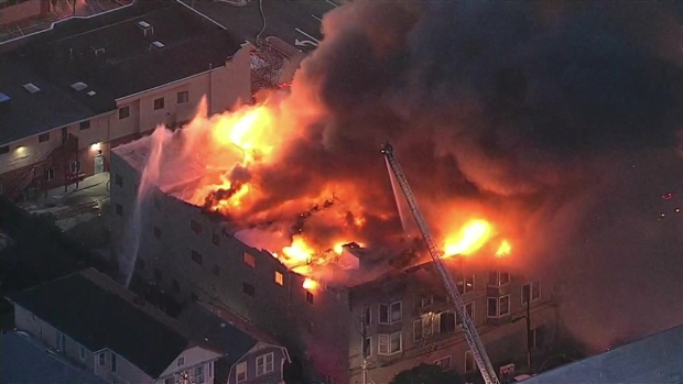 Firefighters battling four-alarm fire in California