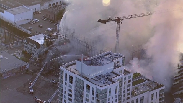 RAW: Four-Alarm Construction Site Fire Prompts Evacuations in Oakland