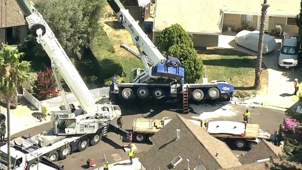 RAW VIDEO: Crane Falls on Roof in Campbell