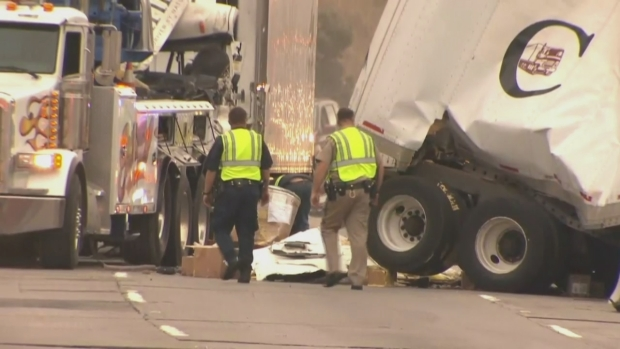 RAW: Two Big Rigs and Sedan Involved a Collision Causes a Morning Traffic Nightmare
