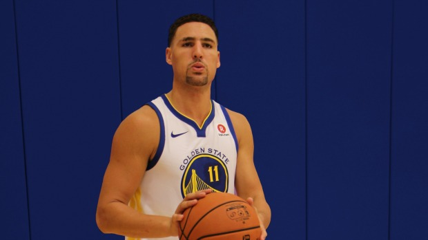 Klay Thompson of the Golden State Warriors wears a jersey with a Rakuten badge