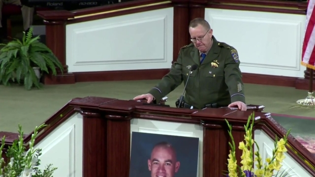 CHP Commander Remembers Fallen Officer's Smile and Love of Action Figures