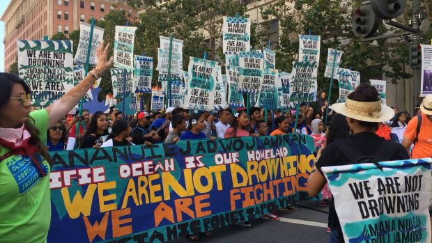 [BAY]PHOTOS: Hundreds 'Rise for Climate, Jobs and Justice' in San Francisco, Nationwide
