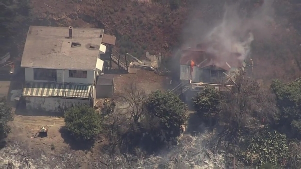 RAW: Brush Fire Burns Structures in San Jose