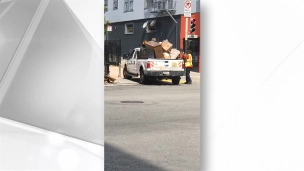 RAW: SFPD Officer Packs Already Overloaded Public Works Truck