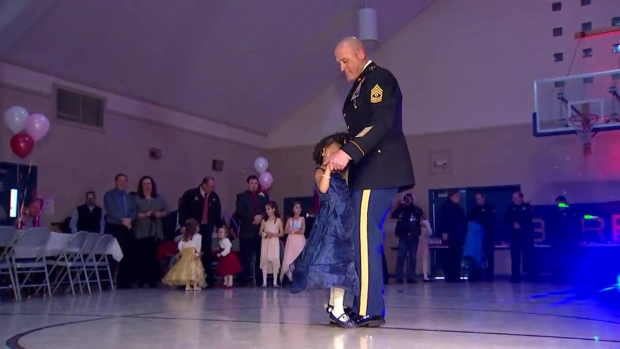 [CHI] Kindergartner Who Lost Father Escorted to Daddy-Daughter Dance by National Guard Soldier
