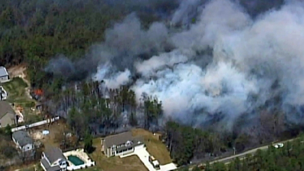[NY] CHOPPER VIDEO: Firefighters Battle Massive Brush Fire in New Jersey