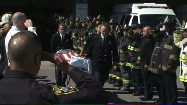 [BAY] Raw Video: Flag-Draped Stretcher Gets Salute by Fellow Firefighters