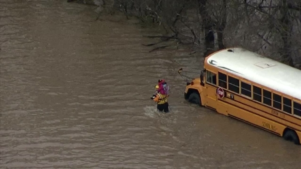 RAW: Crews Rescue Kids from Bus Trapped in High Water
