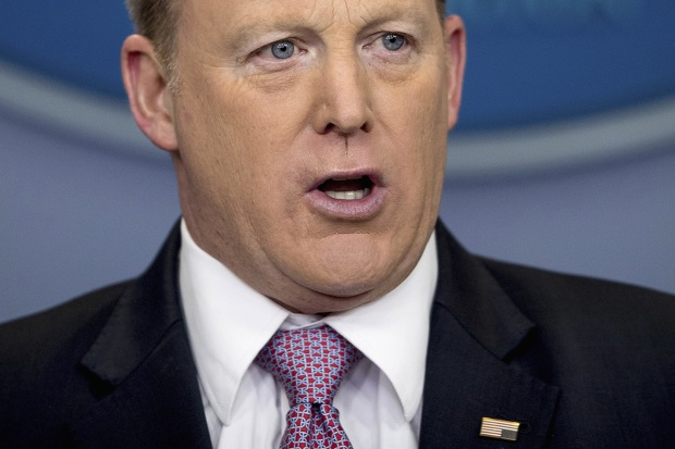 Spicer Wears Upside-Down American Flag Pin During Briefing