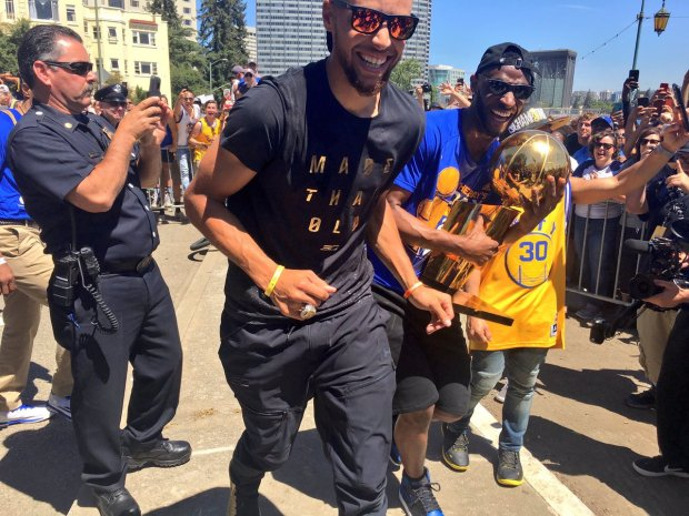 Steph Curry Shows Off the Larry O'Brien Trophy at Warriors Parade