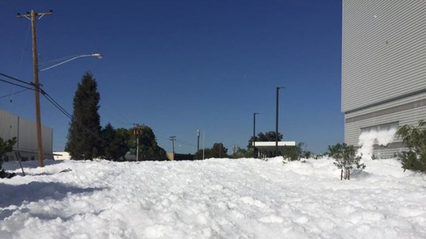 Snow in Santa Clara? Not! Spewing Foam Spills From Airplane Hangar to Street