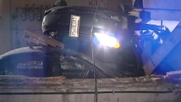 [BAY] Out of Control Car Catches Air & Crashes Into SF Carport