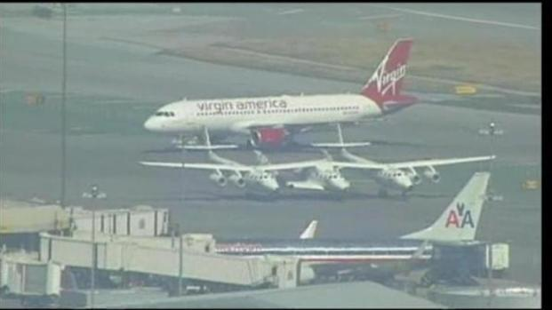 [BAY] Raw Video: Richard Branson' Spaceship Lands at SFO