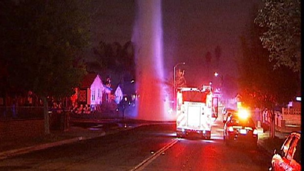25-Foot Geyser Floods Street After Accident