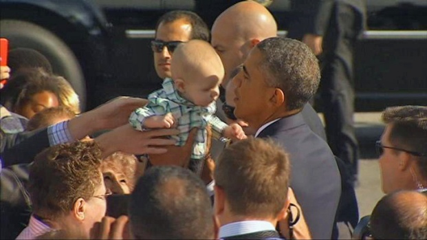 President Obama Poses for Photos, Hugs Babies on SFO Tarmac