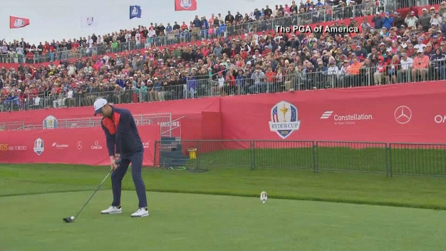 Michael Phelps Warms Up Before He Tees Off