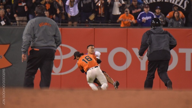 Giants Outfielder Body Slams Fan on Field
