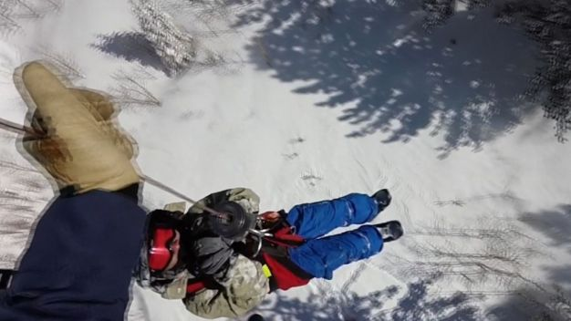 Snowboarder Hoisted to Safety