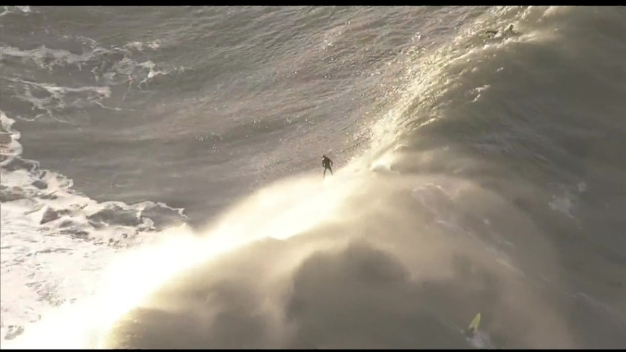 Surfers Brave the Waves at Titans of Mavericks