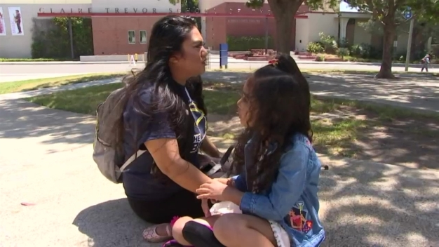 Single Mother Pulls Off a Parental Balancing Act With Daughter by Her Side at UC Irvine
