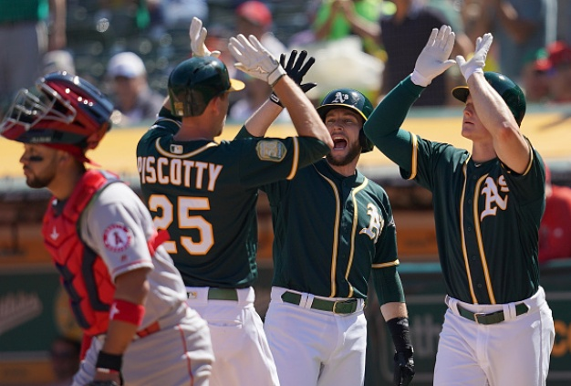 A's Ride the Diamond Carousel to 21-3 Win Over Angels
