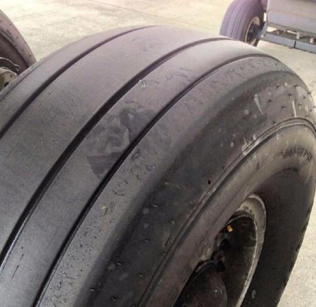 Photo May Show Stowaway's Footprints on Airplane Wheels