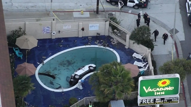 8 Injured After Car Crashes Into Motel Swimming Pool