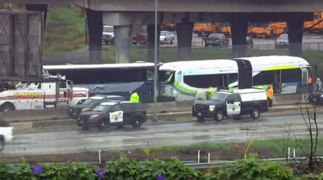 13 Injured When Two Buses Collide on Wet Freeway