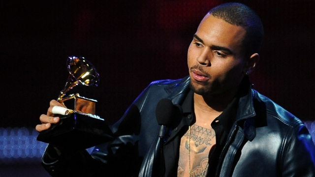 Chris Brown Kiss Kisses His Condo Goodbye