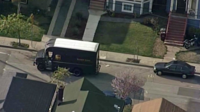 UPS Driver Caught in Crossfire, Flees Vehicle