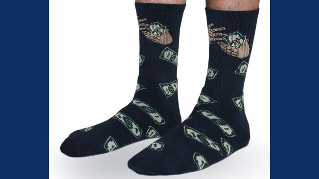 49ers' Kaepernick Sports Money Socks After Signing Extension