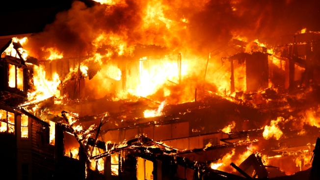 Workers Who Sparked Massive Apartment Fire Never Called 911: Source