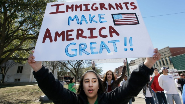 Immigrants, unions march in US for rights, against Trump